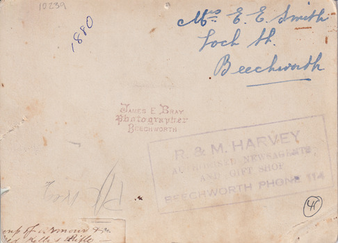 Brown-toned background with various pieces of handwriting and stamped lettering.