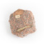 A small, solid granite specimen with a relatively flat top and right side. The colour consists of flecks of pink, red, and grey.  It has three sticker tags (see transcription).