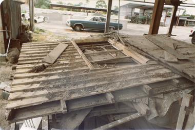 'Box Cottage' dismantled in sections, lying on the floor of the storage building of the Lewis Timber Co Ltd Jasper Road Ormond (1 of 3)