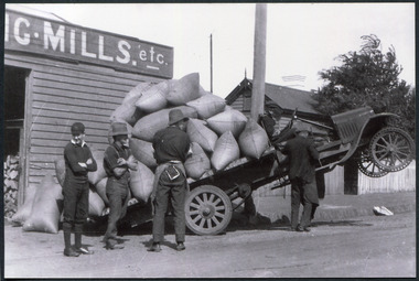 J L Smith, H Higgins Overloaded Ford Truck at Chaff & Grain Store and Mill Bentleigh c1926