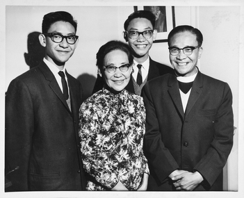 Family portrait of Reverend Wong, his wife and two sons.