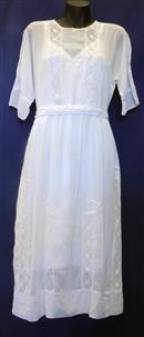 dress: A white voile dress with a white cotton petticoat underneath