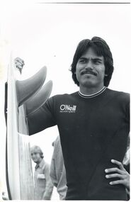 Photograph, Unknown, Reno Abellira Holding Twin Fin Surfboard, circa 1977