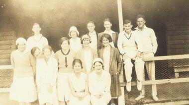 Photograph, Ringwood Tennis Club (undated).  Left Back Row - W. Dwight, Enid Connelly, Les Blood, Lance Lane, R. Skerritt, K. Storey.  Standing - Vicki Cooper, Alex Kerford, Rose Storey, Nell Hargraves, Miss ? Bamford, Mrs. J. Jamieson. Sitting - Miss J. Payne and Miss Edith Blood