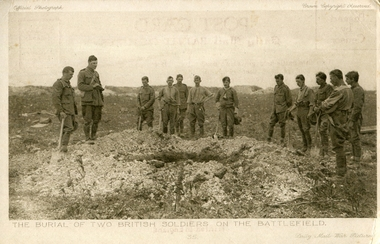 Soldiers stand around a grave