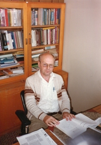 Photograph, Two photos of an academic at the Gippsland Institute of Advanced Education Campus, c2000