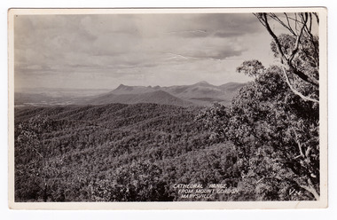 An early black and white photograph of the Cathedral Range taken from Mount Gordon near Marysville in Victoria. The title of the photograph is handwritten in white ink on the lower edge. On the reverse of the postcard is a space to write a message and to place a postage stamp. The postcard is unused. This postcard was produced by the Valentine Publishing Co Pty. Ltd. as a souvenir of Marysville.
