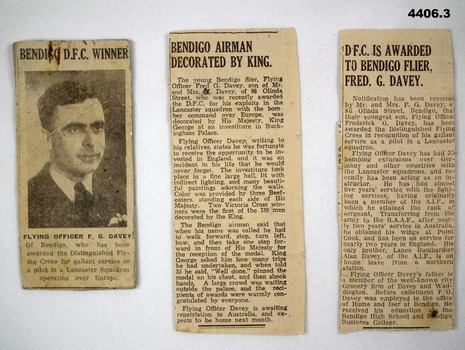 Set of three newspaper cuttings detailing F.G. Davey receiving the DFC.