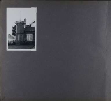 1 photo on page - view of mainly a tower, part of a large brick home