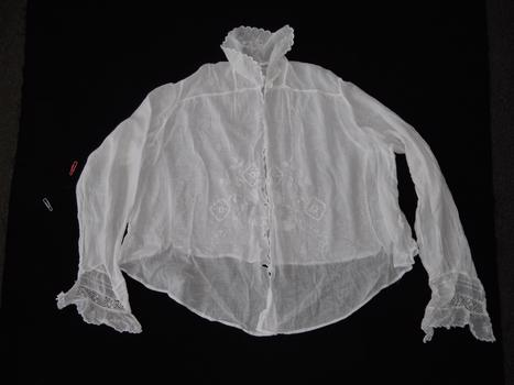 photograph of white blouse on black