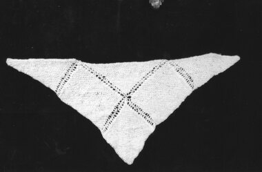 a white knitted woolen shawl