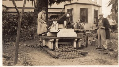 Photograph of the Jenkins family in front of a cannon, c.1940s