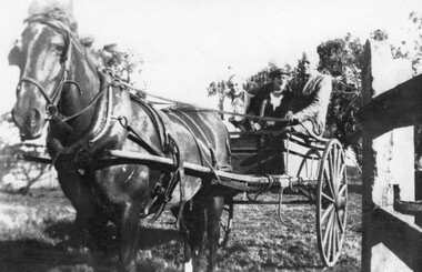 Photograph - Black and white photograph of three people in a cart, c.1939