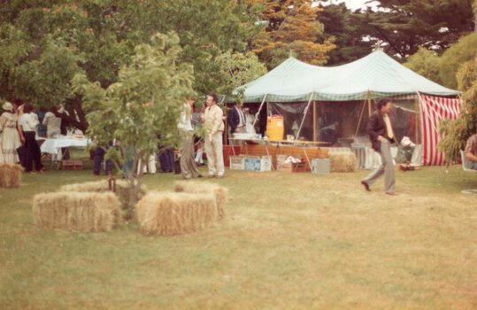 Photograph of market stalls and hay bales