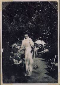 a photograph of standing woman