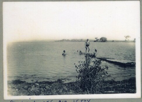Photograph of people swimming in the water