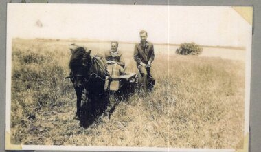Photograph of pony and two men
