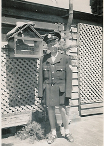 2309 - John Coghlan as a boy, dressed in father's police jacket and hat