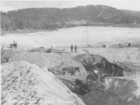 Men working in horses and carts, clearing land to alter the path of a river.