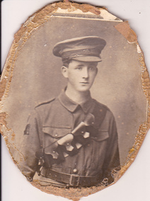 Studio portrait of solder in Australian Infantry Forces uniform.