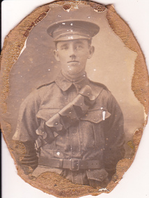 Studio portrait of soldier in Australian Infantry Forces uniform.