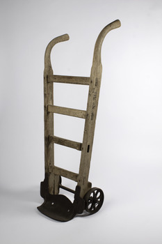 Ship's cargo trolley with 4 braces and one handle longer than the other with heavy metal wheels and step