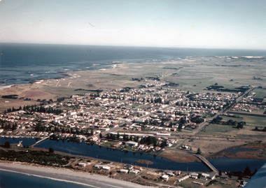 Coloured aerial photograph taken from the sea looking over the Moyne river with the two bridges in the foreground