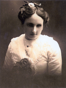 Young woman wearing white blouse and flower in her hair
