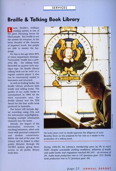 Beverley Dunn reads a book beneath the stained glass window of Shakespeare in the library.