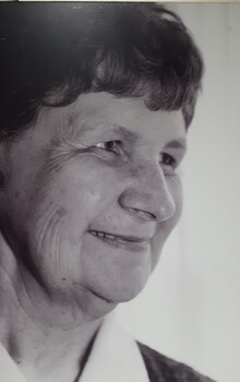 Smiling older female face turning away from camera