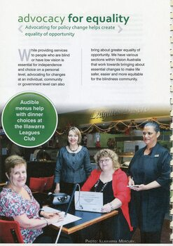Two woman sit at a table at the Illawarra Leagues Club, one reading Braille menu, the other large print, with two other woman looking on