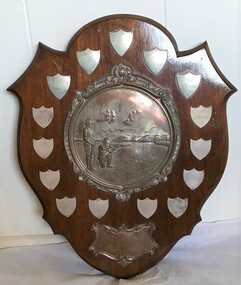 Decorative wooden and metal shooting trophy.