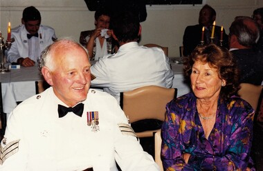 couple sitting  at dining table