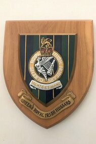 Wooden plaque with badge and title