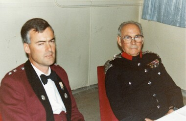 Two officers in formal uniform