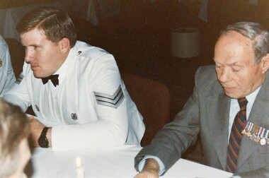 Soldier in formal uniform and a civilian