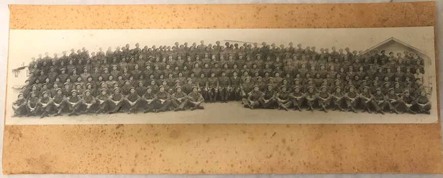 Photograph of large group of soldiers all wearing berets.