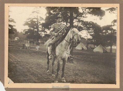 Soldier with rifle on horseback
