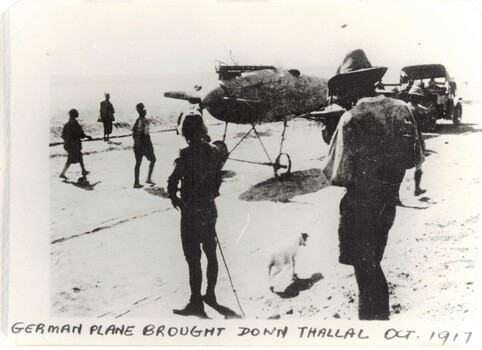 Soldiers near very old aircraft in desert