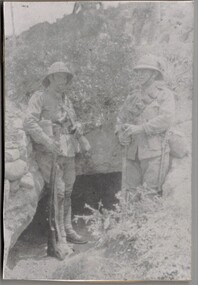 Two soldiers standing in trench.