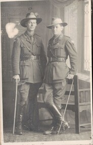 Two army officers with walking canes