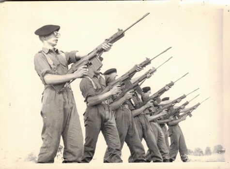 Six soldiers training with rifles.