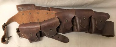 Leather sash with small pouches attached.