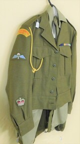 Army jacket with coloured badges on sleeve.