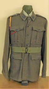Khaki army uniform with webbing belt