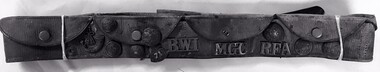 Leather belt with pockets and badges