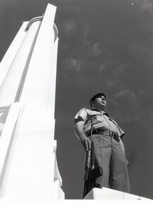 Soldier with rifle near  War  Memorial