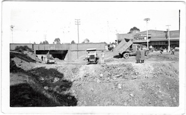 Filling in the Outer Circle Railway cutting at East Kew