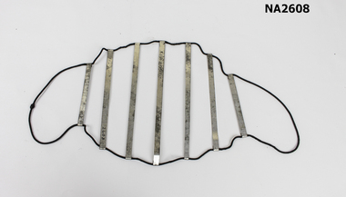A type of net made from a large loop of black elastic with seven steel strips.