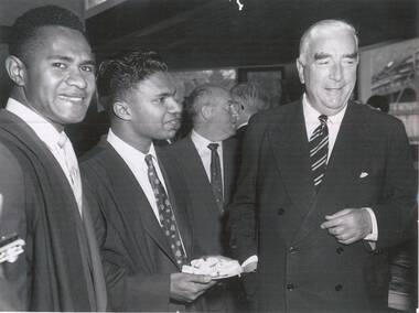 Photograph, Australian News and Information Bureau, Josevats Komikamica (a commerce student from Fiji) and John Daniel (medical student from India) with Prime Minister of Australia Robert Menzies after the official opening of International House, The University of Melbourne, 24/05/1958
